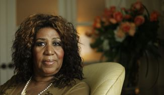 This July 26, 2010, file photo shows performer Aretha Franklin in Philadelphia. As the anniversary of her death approaches, two of her doctors tell The Associated Press that the Queen of Soul handled the diagnosis and treatment with grace and the grit to keep performing for years with a rare type of cancer. Franklin, who died in Detroit on Aug. 16, 2018, at 76, had pancreatic neuroendocrine cancer. (AP Photo/Matt Rourke, File)