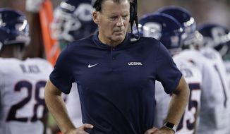 FILE - In this Oct. 20, 2018, file photo, Connecticut head coach Randy Edsall watches from the sideline during the first half of an NCAA college football game against South Florida, in Tampa, Fla. Edsall doesn't talk about conference championships or bowl games when he speaks of the Huskies' goals for their final season in the American Athletic Conference. He just wants to see his football team improve. It would be hard for the Huskies to get much worse than they were a year ago .(AP Photo/Chris O'Meara, File)