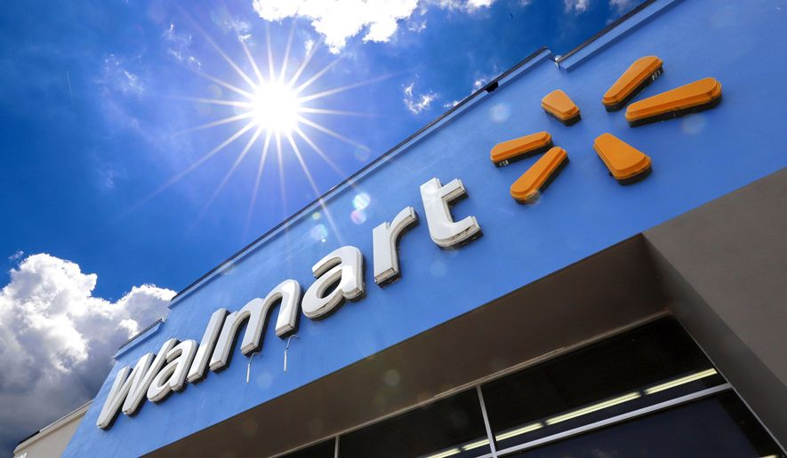 FILE - This June 25, 2019, file photo shows the entrance to a Walmart in Pittsburgh. Walmart Inc. reports financial results Thursday, Aug. 15. (AP Photo/Gene J. Puskar, File)