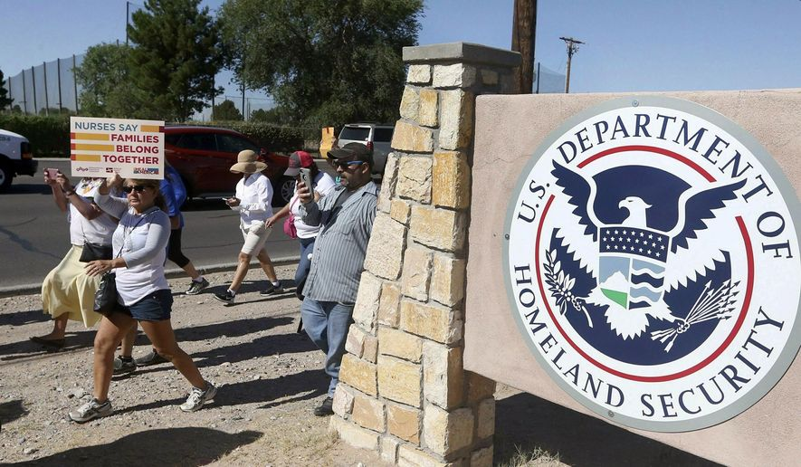 In this June 2018, photo, protesters walk along Montana Avenue outside the El Paso Processing Center in El Paso, Texas. (Rudy Gutierrez/The El Paso Times via AP) **FILE**