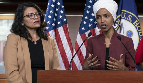 "In this July 15, 2019, file photo, U.S. Rep. Ilhan Omar, D-Minn, right, speaks, as U.S. Rep. Rashida Tlaib, D-Mich. listens, during a news conference at the Capitol in Washington. The U.S. envoy to Israel said he supports Israel's decision to deny entry to two Muslim congresswomen ahead of their planned visit to Jerusalem and the West Bank. Ambassador David Friedman said Thursday, Aug. 15, 2019, in a statement following the Israeli government's announcement that Israel ""has every right to protect its borders"" against promoters of boycotts ""in the same manner as it would bar entrants with more conventional weapons."" (AP Photo/J. Scott Applewhite, File)"
