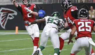 Atlanta Falcons quarterback Matt Ryan dumps off a pass to running back Ito Smith under pressure from New York Jets linebacker Tarell Basham during the first quarter of an NFL football preseason game Thursday, Aug. 15, 2019, in Atlanta. (Curtis Compton/Atlanta Journal Constitution via AP)