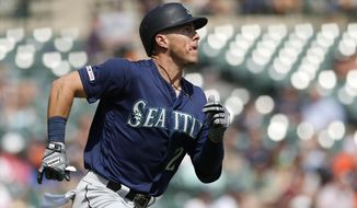 Seattle Mariners' Dylan Moore watches his solo home run during the seventh inning of a baseball game against the Detroit Tigers, Thursday, Aug. 15, 2019, in Detroit. (AP Photo/Carlos Osorio)