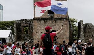 A person waves a Panama flag during the activities celebrating the 500 anniversary of the founding of Panama City, at the site of the ruins of Old Panama, Thursday, Aug. 15, 2019. The city was founded on August 15, 1519 by Spanish conquistador Pedro Arias Davila. On Jan. 28 1671, the Welsh pirate Henry Morgan attacked the city and destroyed it. The attack caused the city to be rebuilt a few kilometers to the west on a new site. (AP Photo/Eric Batista)