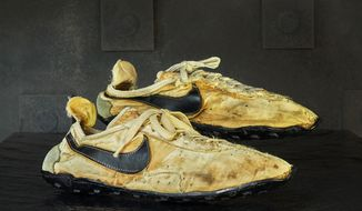 This undated photo provided by Graduate Hotels shows a pair of handmade Nike track shoes from the 1972 Olympic trials. The pair of Nike track shoes has sold for $50,000. (Christian Horan/Graduate Hotels via AP)