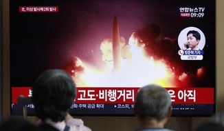 "People watch a TV news program reporting about North Korea's firing projectiles with a file image at the Seoul Railway Station in Seoul, South Korea, Friday, Aug. 16, 2019. South Korea's military said Friday North Korea fired more projectiles into the sea to extend a recent streak of weapons tests believed to be aimed at pressuring Washington and Seoul over slow nuclear diplomacy. The letters read on the top ""North Korea, fired two unidentified projectiles."" (AP Photo/Lee Jin-man)"