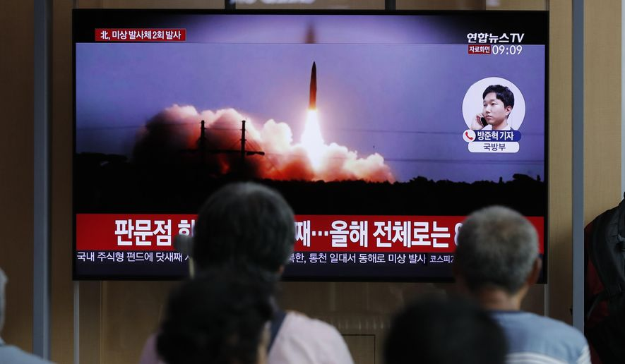 """People watch a TV news program reporting about North Korea's firing projectiles with a file image at the Seoul Railway Station in Seoul, South Korea, Friday, Aug. 16, 2019. South Korea's military said Friday North Korea fired more projectiles into the sea to extend a recent streak of weapons tests believed to be aimed at pressuring Washington and Seoul over slow nuclear diplomacy. The letters read on the top """"North Korea, fired two unidentified projectiles."""" (AP Photo/Lee Jin-man)"""