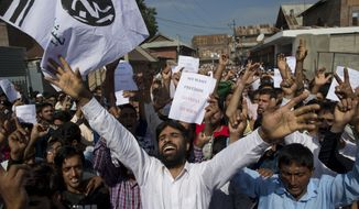 In this Aug. 12, 2019, photo, Kashmiri Muslims shout slogans during a protest after Eid prayers in Srinagar, Indian controlled Kashmir. Troops in India-administered Kashmir allowed some Muslims to walk to local mosques alone or in pairs to pray for the Eid al-Adha festival on Monday during an unprecedented security lockdown that still forced most people in the disputed region to stay indoors on the Islamic holy day. (AP Photo/Dar Yasin)