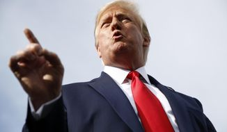 President Donald Trump speaks with reporters before boarding Air Force One at Morristown Municipal Airport in Morristown, N.J., Thursday, Aug. 15, 2019, en route to a campaign rally in Manchester, N.H. (AP Photo/Patrick Semansky)