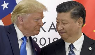 FILE - In this June 29. 2019, file photo, President Donald Trump, left, meets with Chinese President Xi Jinping during a meeting on the sidelines of the G-20 summit in Osaka, Japan. Trump is prioritizing China trade negotiations over defending the Hong Kong protesters. This contrasts with the stance normally taken by his White House predecessors, who would use such a flashpoint as a moment to espouse an American commitment to democratic values.(AP Photo/Susan Walsh, File)