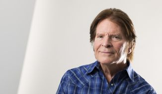 In this Tuesday, Aug. 6, 2019, photo, John Fogerty poses for a photo at an interview with The Associated Press in New York. (Photo by Brian Ach/Invision/AP)