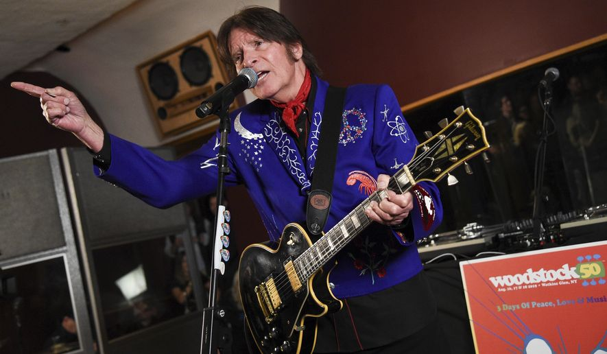 In this March 19, 2019, file photo, musician John Fogerty performs at the Woodstock 50 lineup announcement at Electric Lady Studios in New York. (Photo by Evan Agostini/Invision/AP, File)