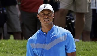 Tiger Woods watches his ball after hitting from a sand trap on the fourth hole during the first round of the BMW Championship golf tournament at Medinah Country Club, Thursday, Aug. 15, 2019, in Medinah, Ill. (AP Photo/Nam Y. Huh) **FILE**