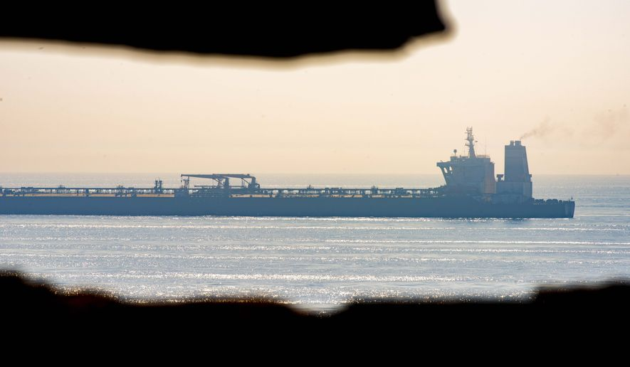 A view of the Grace 1 supertanker stands off the coast of the British territory of Gibraltar, Friday Aug. 16, 2019.  The lawyer representing the captain of the Iranian supertanker caught in a diplomatic standoff said Friday that the captain no longer wants to be in command of the ship, which is in need of repairs that could prevent its immediate departure from Gibraltar. (AP Photo/Marcos Moreno)
