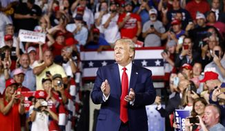 President Donald Trump walks onstage to speak at a campaign rally, Thursday, Aug. 15, 2019, in Manchester, N.H. (AP Photo/Patrick Semansky)
