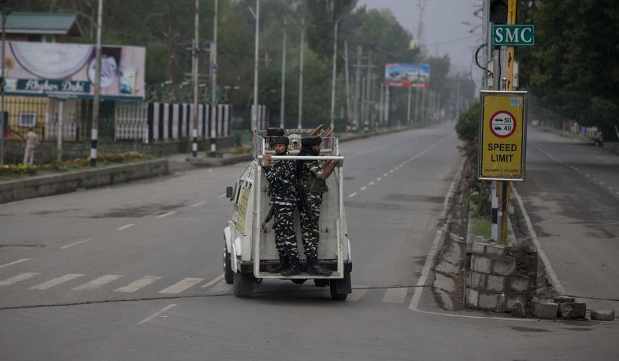 Indian paramilitary soldiers inside an armored vehicle keep vigil during security lockdown in Srinagar, Indian controlled Kashmir, Thursday, Aug. 15, 2019.  Indian Prime Minister Narendra Modi defended his government's controversial measure to strip the disputed Kashmir region of its statehood and special constitutional provisions in an Independence Day speech Thursday, as about 7 million Kashmiris stayed indoors for the 11th day of an unprecedented security lockdown and communications blackout. (AP Photo/Dar Yasin)
