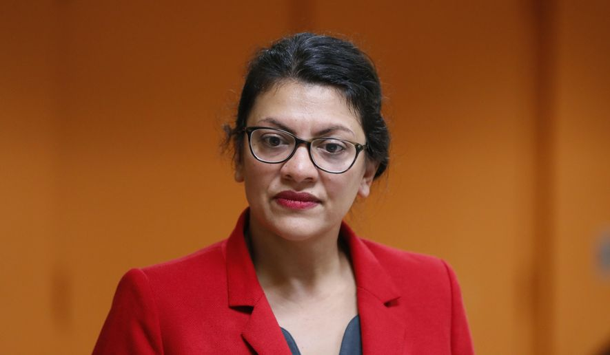 U.S. Rep. Rashida Tlaib, D-Mich., listens to a question from a constituent in Wixom, Mich., Thursday, Aug. 15, 2019. (AP Photo/Paul Sancya)  ** FILE **