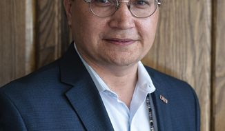 FILE - In this May 16, 2019 file photo, Chuck Hoskin Jr., former Secretary of State of the Cherokee Nation and then Cherokee Nation principal chief candidate, stands for a portrait before the Cherokee Nation Principal Chief Forum in Claremore, Okla. Hoskin Jr., the newly elected chief of the Oklahoma-based Cherokee Nation, plans to appoint the tribe's first-ever delegate to the U.S. House of Representatives, which is outlined in a nearly 200-year-old treaty with the federal government. (Joseph Rushmore/Tulsa World via AP, File)
