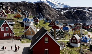 This July 11, 2015 file photo shows a general view of the town of Upernavik in western Greenland. Aiming to put his mark on the world map, President Donald Trump has talked to aides and allies about buying Greenland for the U.S. A Trump ally told The Associated Press on Thursday, Aug. 15, 2019 that the president had discussed the purchase but was not serious about it. And a Republican congressional aide said Trump brought up the notion of purchasing Greenland in conversations with lawmakers enough times to make them wonder, but they have not taken his comments seriously. (Linda Kastrup/Ritzau Scanpix via AP) **FILE**