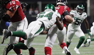 New York Jets inside linebacker Avery Williamson (54) sacks Atlanta Falcons quarterback Matt Ryan (2) during the first half an NFL preseason football game, Thursday, Aug. 15, 2019, in Atlanta. (AP Photo/John Bazemore)