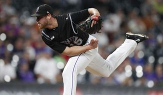 Colorado Rockies relief pitcher Scott Oberg works against the Miami Marlins during the ninth inning of a baseball game Friday, Aug. 16, 2019, in Denver. The Rockies won 3-0. (AP Photo/David Zalubowski)