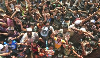 FILE - In this Nov. 15, 2018, file photo, Rohingya refugees shout slogans against repatriation at Unchiprang camp near Cox's Bazar, in Bangladesh. Myanmar and Bangladesh are making a second attempt to start repatriating Rohingya Muslims after more than 700,000 of them fled a security crackdown in Myanmar almost two years ago, the U.N. refugee agency said Friday, Aug. 16, 2019. (AP Photo/Dar Yasin, File)