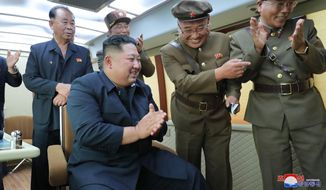 "In this Friday, Aug. 16, 2019, photo provided Saturday, Aug. 17, by the North Korean government, North Korean leader Kim Jong Un, center, watches the test firing of an unspecified new weapon at an undisclosed location in North Korea. North Korea on Saturday said leader Kim supervised another test-firing of an unspecified new weapon that extended a streak of weapons demonstrations seen as an attempt to pressure Washington and Seoul over slow nuclear negotiations and their joint military exercises.  The content of this image is as provided and cannot be independently verified. Korean language watermark on image as provided by source reads: ""KCNA"" which is the abbreviation for Korean Central News Agency. (Korean Central News Agency/Korea News Service via AP)"