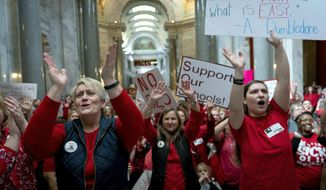 FILE - In this March 12, 2019 file photo, a group of the several hundred teachers gather to protest perceived attacks on public education at the Capitol in Frankfort, Ky. Kentucky's labor secretary says more than 1,000 teachers violated state law by participating in mass rallies at the state Capitol that forced some schools to close. But Labor Secretary David Dickerson says no penalties will be assessed. The protests over several education bills were part of a wave of teacher activism that began last year in West Virginia and spread to other states, including Oklahoma and Arizona. (AP Photo/Bryan Woolston, File)