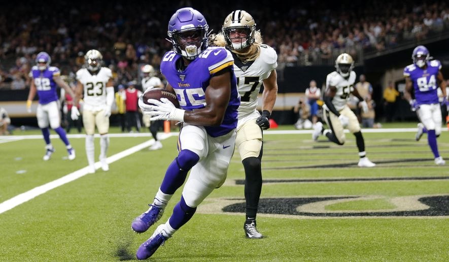 FILE - In this Friday, Aug. 9, 2019 file photo, Minnesota Vikings running back Alexander Mattison (25) pulls in a touchdown reception in front of New Orleans Saints middle linebacker Alex Anzalone (47) in the first half of an NFL preseason football game in New Orleans. With rookie Alexander Mattison at the top of the candidate list and Ameer Abdullah returning after a late-season arrival last year, the Minnesota Vikings are looking for another running back to emerge as a reliable complement to Dalvin Cook. (AP Photo/Gerald Herbert, File)