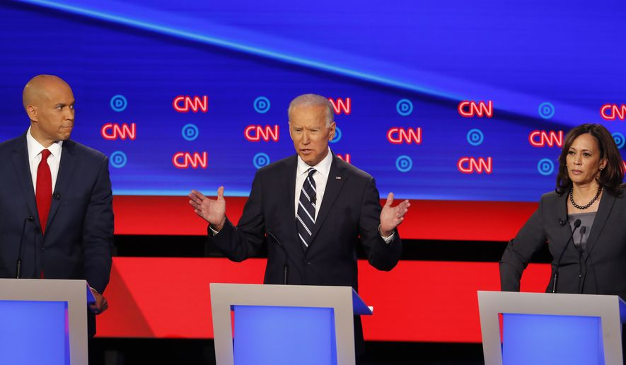 Sen. Cory Booker, D-N.J., from left, former Vice President Joe Biden, and Sen. Kamala Harris, D-Calif. participate in the second of two Democratic presidential primary debates hosted by CNN, July 31, 2019, in the Fox Theatre in Detroit. (AP Photo/Paul Sancya)