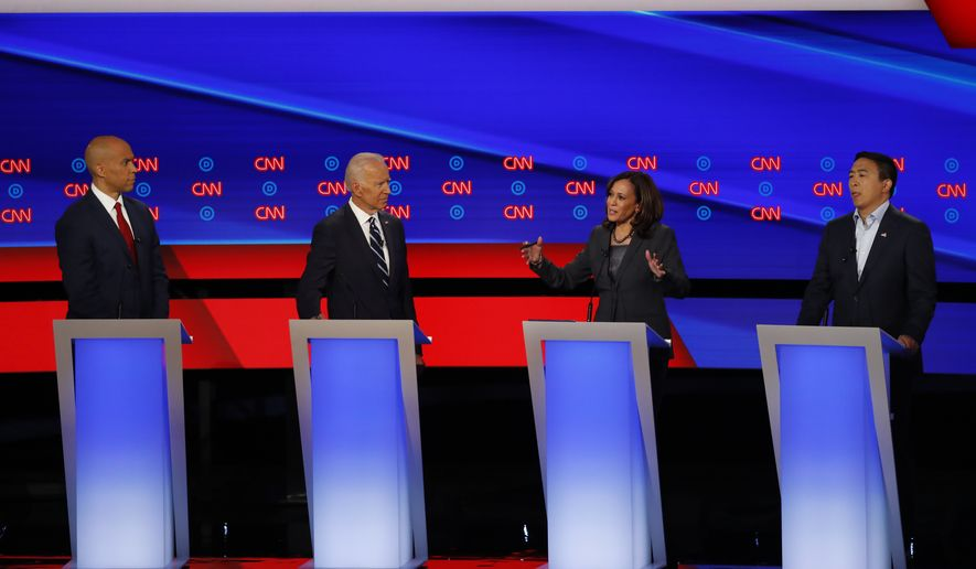 Sen. Cory Booker, D-N.J., from left, former Vice President Joe Biden, Sen. Kamala Harris, D-Calif., and Andrew Yang participate in the second of two Democratic presidential primary debates hosted by CNN, July 31, 2019, in the Fox Theatre in Detroit. (AP Photo/Paul Sancya) ** FILE **