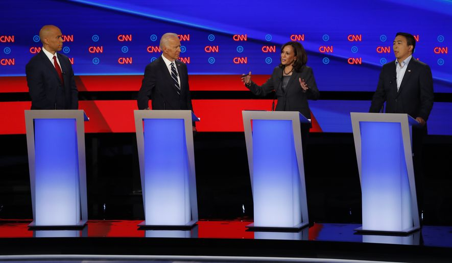 Sen. Cory Booker, D-N.J., from left, former Vice President Joe Biden, Sen. Kamala Harris, D-Calif., and Andrew Yang participate in the second of two Democratic presidential primary debates hosted by CNN, July 31, 2019, in the Fox Theatre in Detroit. (AP Photo/Paul Sancya)