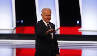 Former Vice President Joe Biden waves after the second of two Democratic presidential primary debates hosted by CNN, July 31, 2019, in the Fox Theatre in Detroit. (AP Photo/Paul Sancya)