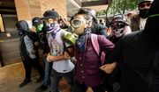 """Protesters gathered to oppose right-wing demonstrators face off against police following an """"End Domestic Terrorism"""" rally in Portland, Ore., on Saturday, Aug. 17, 2019. Although the main protest remained largely peaceful, some skirmishes erupted in the following hours and police detained multiple protesters. (AP Photo/Noah Berger)"""