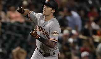 San Francisco Giants' Mike Yastrzemski runs the bases after hitting a solo home run during the 11th inning of the team's baseball game against the Arizona Diamondbacks, Friday, Aug. 16, 2019, in Phoenix. It was Yastrzemski's third home run of the game. (AP Photo/Matt York)