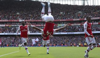 Arsenal's Pierre-Emerick Aubameyang, centre, celebrates scoring his side's first goal of the game, during the English Premier League soccer match between Arsenal and Burnley FC, at The Emirates Stadium, in London, Saturday, Aug. 17, 2019. (Yui Mok/PA via AP)