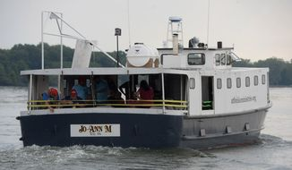 In this July 31, 2019, photo, the JoAnn-M leaves the Waterworks Ferry Dock at Presque Isle State Park, in Erie, Pa. The boat and its crew of Lake Fishing Ministries provides fishing and boating experiences to people with special needs. (Jack Hanrahan/Erie Times-News via AP)