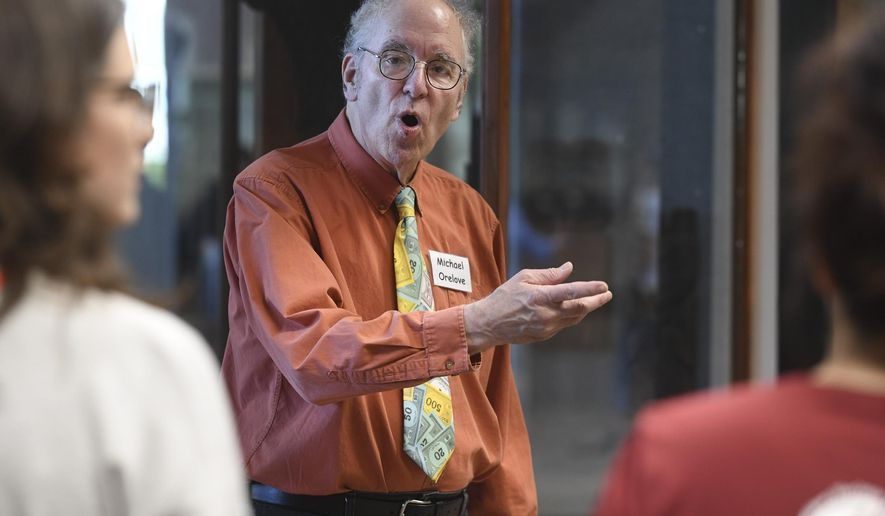 In this Friday, Aug. 9, 2019 photo Michael Orelove, one of the original committee members that established the 1994 Juneau Time Capsule, talks about the project on its 25th Anniversary at the Hurff Ackerman Saunders Federal Building in Juneau. The capsule is set to be opened in 75 more years.(Michael Penn/Juneau Empire via AP)