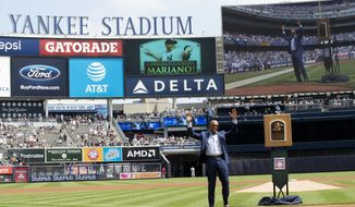 Former New York Yankees pitcher and hall of famer Mariano Rivera waves as the crowd as arrives on the field for a ceremony before a baseball game between the New York Yankees and the Cleveland Indians, Saturday, Aug. 17, 2019, in New York. (AP Photo/Mary Altaffer)