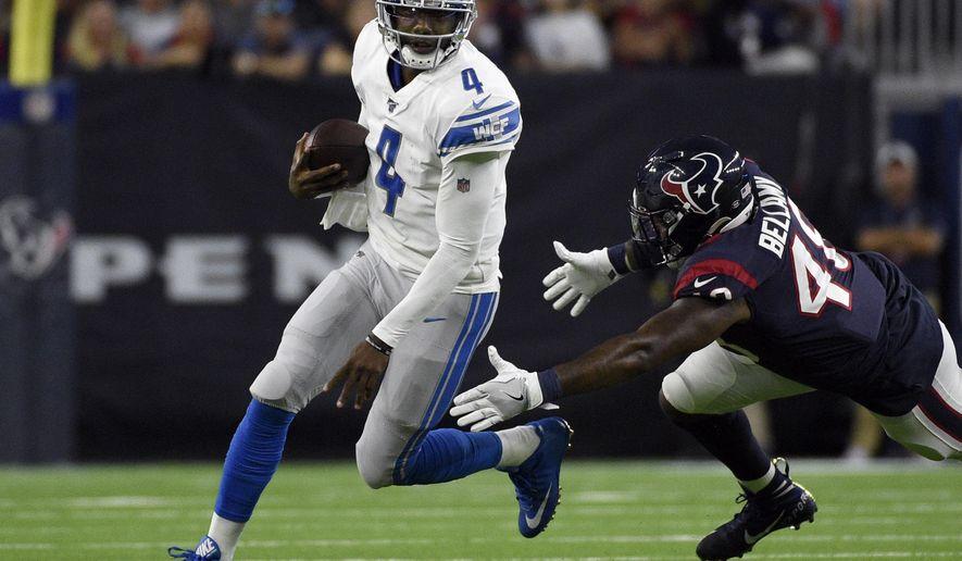 Detroit Lions quarterback Josh Johnson (4) avoids Houston Texans linebacker Davin Bellamy during the first half of an NFL preseason football game Saturday, Aug. 17, 2019, in Houston. (AP Photo/Eric Christian Smith)