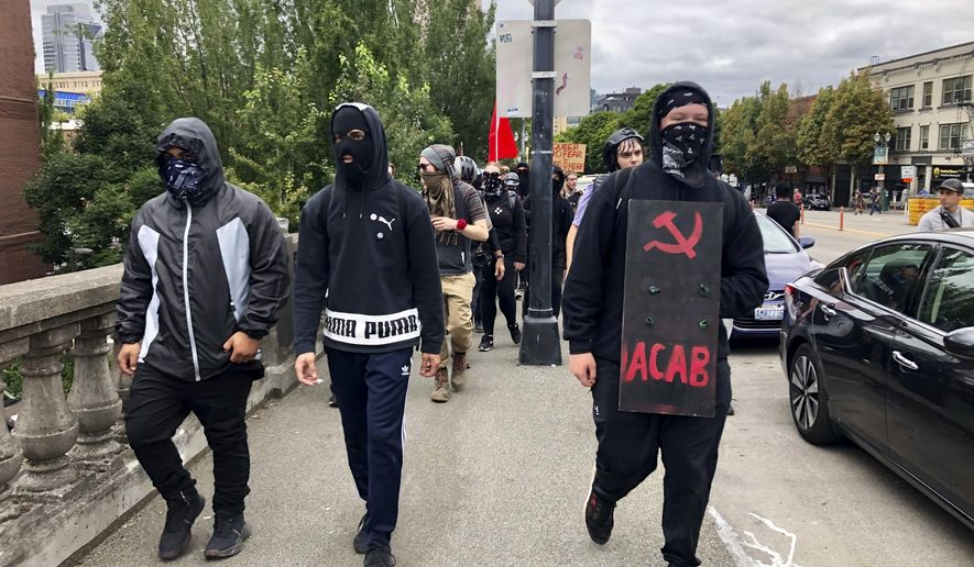 Anti-fascist counter-demonstrators cross the Burnside Bridge across the Willamette River from the west side of the city to the east side in search of the far-right group, the Proud Boys, in Portland, Ore., Saturday, Aug. 17, 2019. (AP Photo/Gillian Flaccus) **FILE**