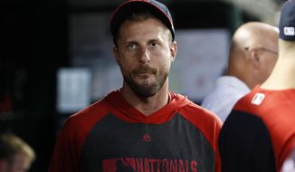 Washington Nationals starting pitcher Max Scherzer walks in the dugout during the fourth inning of a baseball game against the Cincinnati Reds at Nationals Park, Monday, Aug. 12, 2019, in Washington. (AP Photo/Alex Brandon) ** FILE **