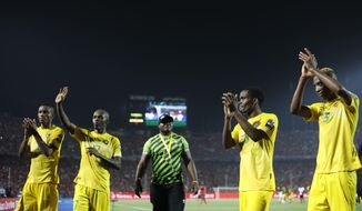 FILE  - In this Wednesday, June 26, 2019 file photo, Zimbabwe players applaud their fans after the group A soccer match between Uganda and Zimbabwe at the Africa Cup of Nations at Cairo International Stadium in Cairo, Egypt. Zimbabwe's government-run sports commission says it has asked FIFA to remove officials in charge of the country's soccer federation from office and appoint a temporary committee. The Sports and Recreation Commission regulates sport in Zimbabwe and says it wants the Zimbabwe Football Association to be run by a normalization committee. (AP Photo/Ariel Schalit, File)