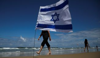 The beach is at the center of the latest campaign ads in Israel. Prime Minister Benjamin Netanyahu portrays himself as an ever-vigilant lifeguard, while his main rival, the Blue and White Party, shows people ducking for cover in the sand as rocket sirens blare. (Associated Press/File)