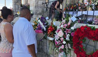 Mourners deliver flowers Friday for the funeral in El Paso, Texas, of Margie Reckard, 63, who was killed by a gunman in a mass shooting earlier in the month. Some mental health advocates say that the focus on people with mental illness is a distraction from solving gun violence in the U.S. (Associated Press)