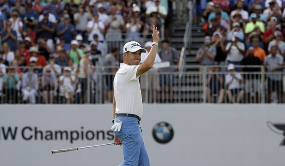Justin Thomas waves to fans as he walks to the 18th green during the final round of the BMW Championship golf tournament at Medinah Country Club, Sunday, Aug. 18, 2019, in Medinah, Ill. He finished under 25. (AP Photo/Nam Y. Huh)