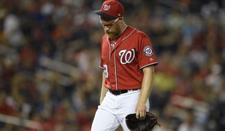 Washington Nationals' Sean Doolittle walks to the dugout after he was pulled from the baseball game during the ninth inning against the Milwaukee Brewers, Saturday, Aug. 17, 2019, in Washington. The Brewers won 15-14 in 14 innings. (AP Photo/Nick Wass) ** FILE **