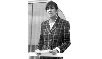 """In this Nov. 7, 1991, file photo Ghislaine Maxwell, daughter of late British publisher Robert Maxwell, reads a statement in Spanish in which she expressed her family's gratitude to the Spanish authorities, aboard the """"Lady Ghislaine"""" in Santa Cruz de Tenerife. Ghislaine is one of the most prominent figures left from the orbit of Jeffrey Epstein after his suicide in jail while awaiting trial on sex trafficking charges. (AP Photo/Dominique Mollard, File)"""