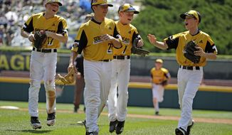 South Riding, Virginia pitcher Justin Lee (22) celebrates as he walks off the field with Chase Obstgarten, left, Matt Colman (1), and Colton Hicks (9) getting the final out of the fourth inning and an 11-0 win over Coon Rapids, Minnesota in a baseball game at the Little League World Series tournament in South Williamsport, Pa., Sunday, Aug. 18, 2019. Lee allowed no hits in the contest. (AP Photo/Gene J. Puskar)