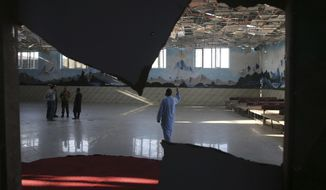 Damaged Dubai City wedding hall is seen after an explosion in Kabul, Afghanistan, Sunday, Aug.18, 2019.  A suicide-bomb blast ripped through a wedding party on a busy Saturday night. (AP Photo/Rafiq Maqbool)